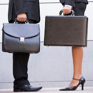 Man and woman standing with briefcases