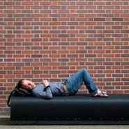 student sleeping on couch on campus