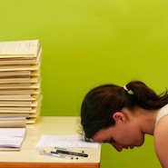Stressed student with head on desk
