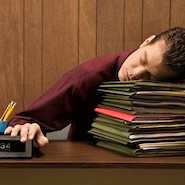 Man lying on books napping