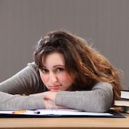 Student resting on desk