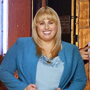 Rebel Wilson smiling in a blue suit