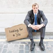 Male lawyer sitting on curb