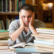Student stressed with books