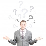 businessman with question marks around his head
