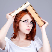 Woman holding book over her head