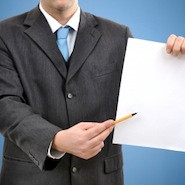 Man pointing to blank piece of paper