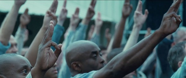 Citizens from District 11 Returning Katniss' Salute, from the move, The Hunger Games