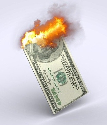 A burning American one hundred dollar bill
