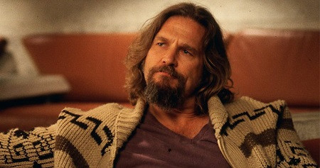 "The Dude sitting on a couch, staring off into space, in movie, ""The Big Lebowski"""
