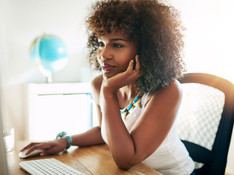 young-black-girl-working-on-computer-PLN