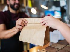 man-or-bartender-serving-customer-at-cof