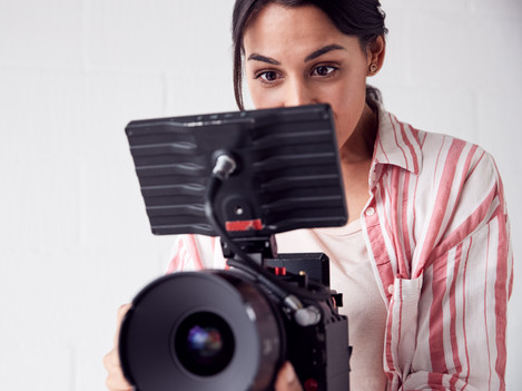 female-videographer-with-video-camera-fi