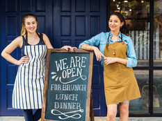 cheerful-business-owners-standing-with-o