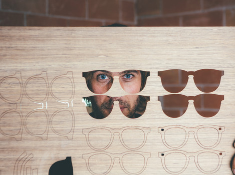 craftsman-looking-through-wooden-blank-P