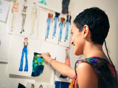 female-fashion-designer-contemplating-dr