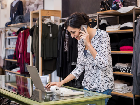 entrepreneur-talking-at-phone-in-shop-PE