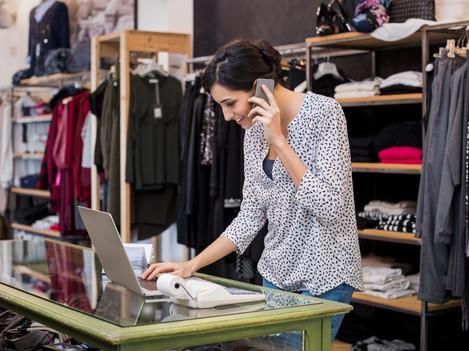 entrepreneur-talking-at-phone-in-shop-PE