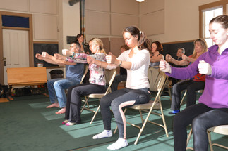 Students in chair doing an Awareness Through Movement® lesson