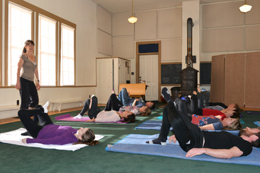 Students on mat doing an Awareness Through Movement® lesson