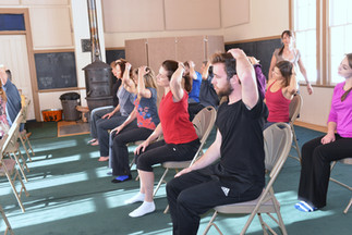 Students on chairs doing an Awareness Through Movement® lesson