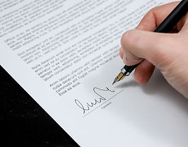 document being signed with a fountain pen