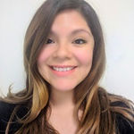 Michelle Gastulo smiling, long brown hair.