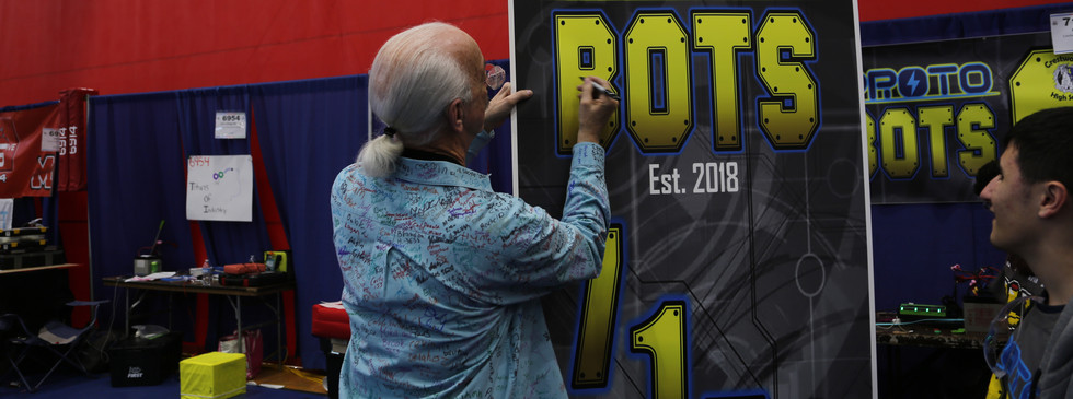 Woody Flowers signing our banner