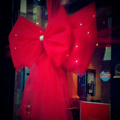 Red Christmas.Red Christmas Bow With Fairy Lights And Diamante Centre