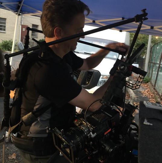 Cinematographer Jim Zunt prepping his gear.