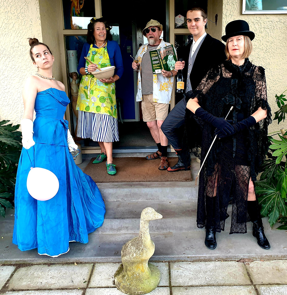 Family members dressed up in costumes on a front porch.