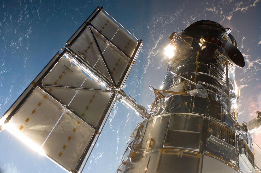 The Hubble Space Telescope traveling in outer space