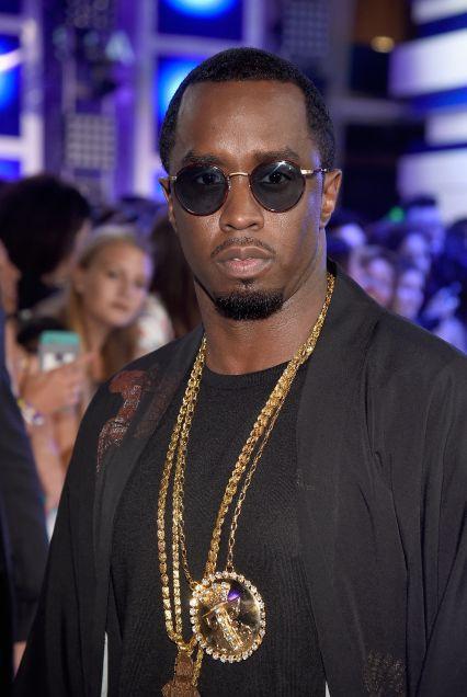 P. Diddy wearing SLJ Pendant