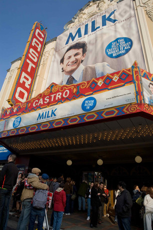 Audience members embrace outside the theatre  after seeing Milk at the Castro Theatre, November 28, 2008