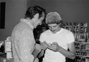 Harvey Milk and Denton Smith sharing the daily comic strip - 1976