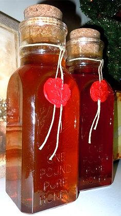16 oz. wildflower honey in Apothecary jar