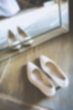 Pretty pair of wedding shoes reflected in mirror