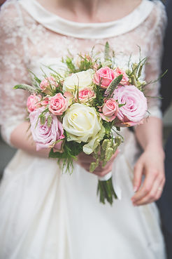 Wedding bouquet of flowers held by bride. Roses