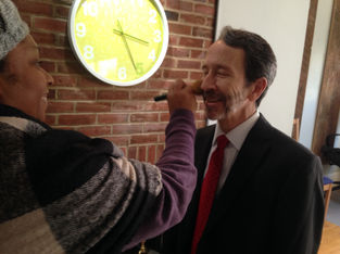Nikki Smallwood applies make-up to Ned Read