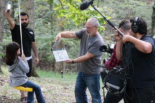 Director, David Stern (with slate) and actress, Carolena Arias (Kaylah)