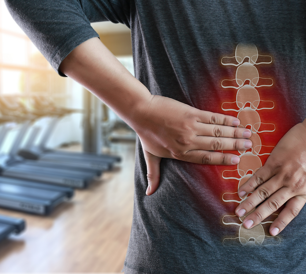 Image spine with man holding back
