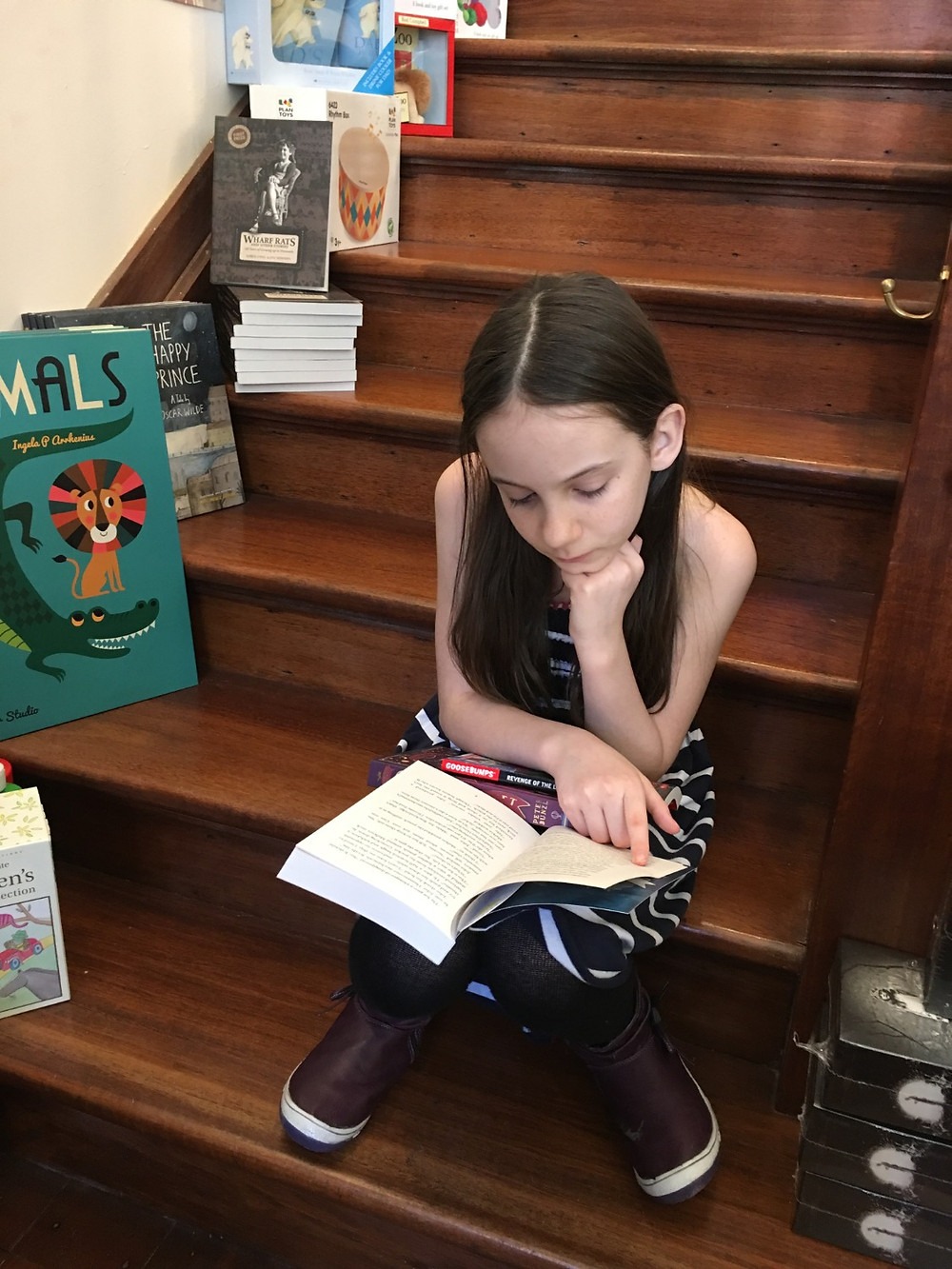 Azalia reading Cogheart by Peter Bunzl