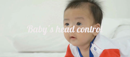 When will my baby be able to hold up and control their head?