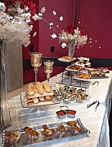 Red and white catering food buffet with pinstripe linen tablecloth and 3-tier trays