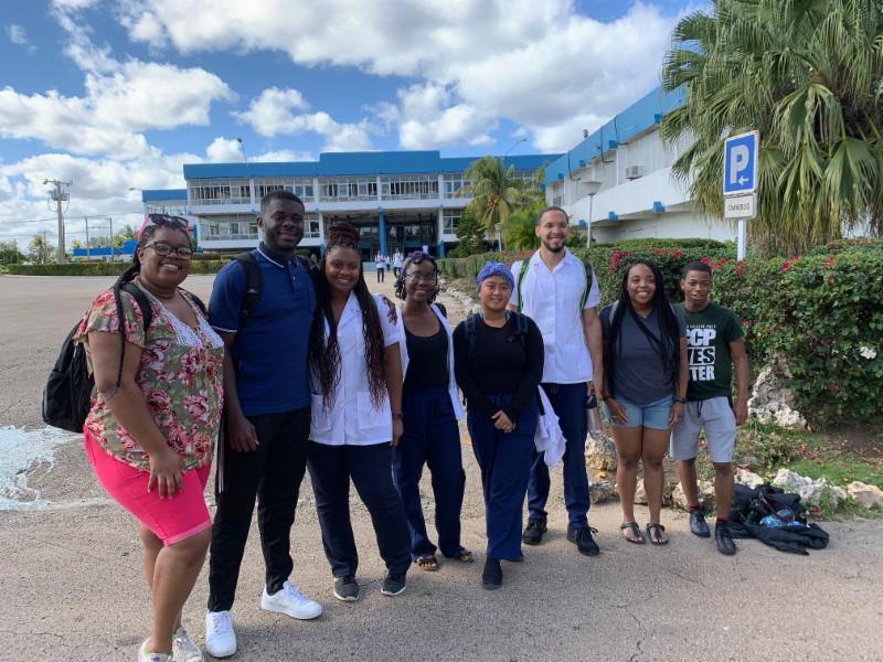 Left, American Students studying medicine for FREE at ELAM Medical School in Cuba stopped to visit with our students and share their experiences.