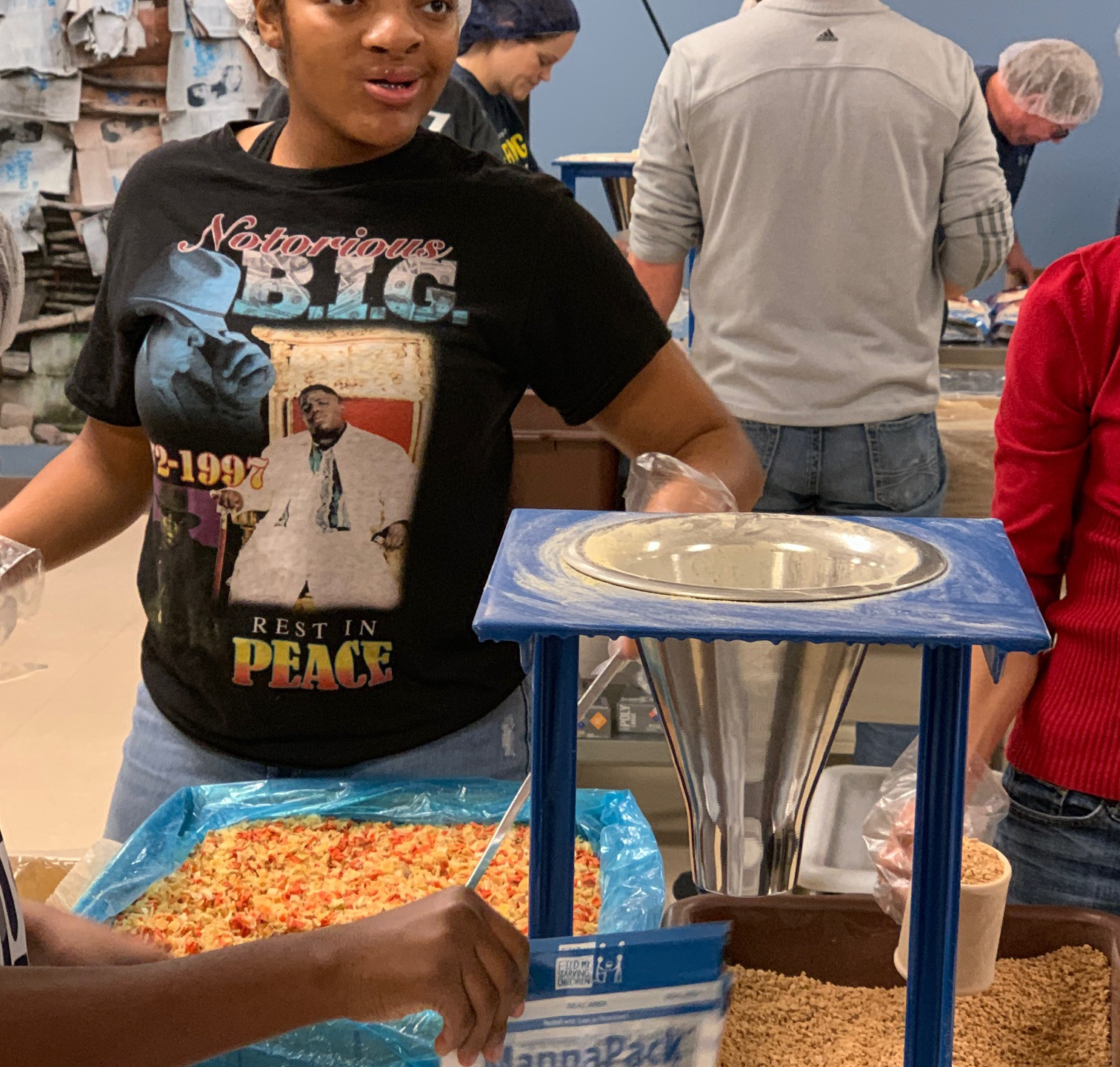 I Am Abel Foundation Mentee and High School Senior Kiden Kee lends a hand in mixing.