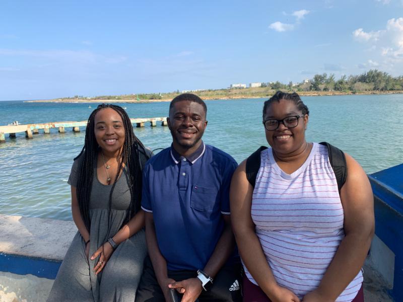 Klarque, Clinton and Aria enjoying a cool breeze on pier