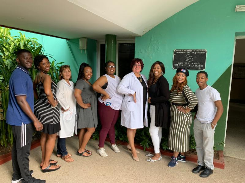 Pictured above are Clinton Osei, Angela Madison, Klarque Scott Aria Caldwell, Dr. Sweetie Conway, Dr. Carletha Hughes, Camari Jones and staff of the Maternal Hospital