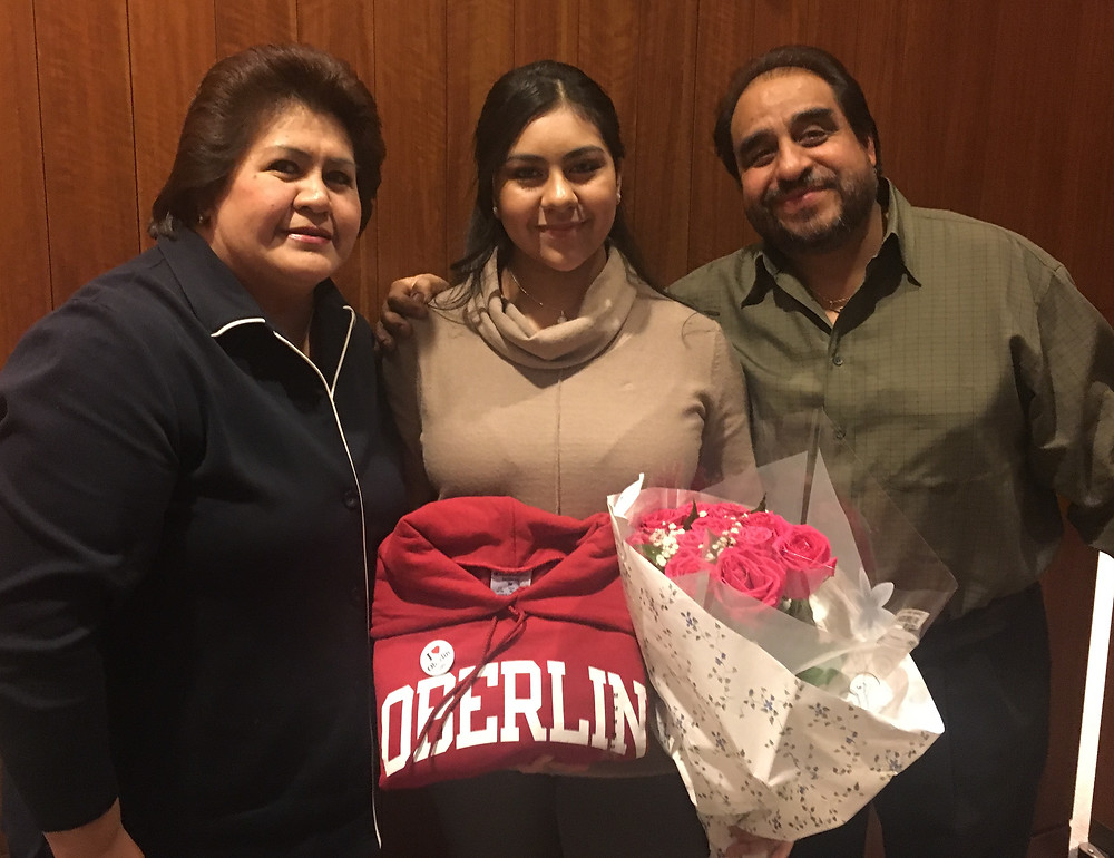 Diana Guzman, pictured with her parents at awards night.