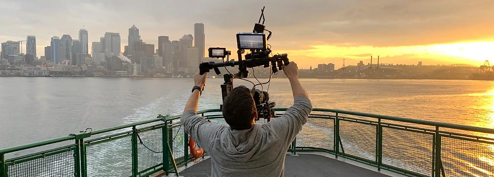 Cameraman filming Seattle Skyline